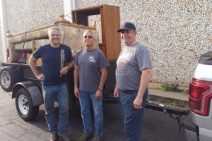 Knights in Action – helping clean out a home