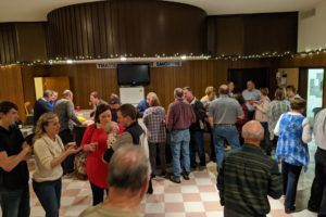 Fun and Fundraising at the Annual Christmas Community Service Celebration Potluck